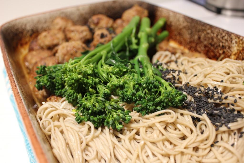 Sticky sesame pork meatballs with soba noodles